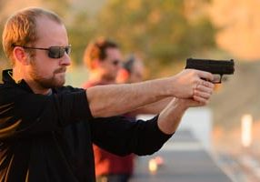man enjoys gun class at central texas range